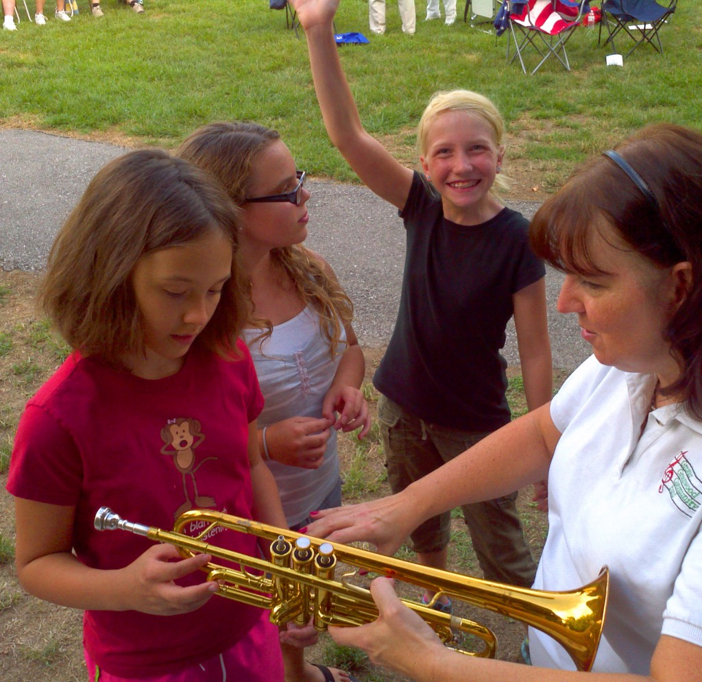 Kids trying real band instruments